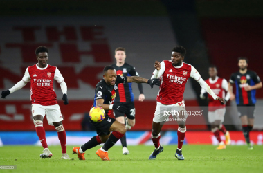 <div>Arsenal v Crystal Palace - Premier League</div><div><br></div><div>LONDON, ENGLAND - JANUARY 14: Thomas Partey of Arsenal battles for possession with Jordan Ayew of Crystal Palace during the Premier League match between Arsenal and Crystal Palace at Emirates Stadium on January 14, 2021 in London, England. Sporting stadiums around England remain under strict restrictions due to the Coronavirus Pandemic as Government social distancing laws prohibit fans inside venues resulting in games being played behind closed doors. (Photo by Julian Finney/Getty Images)</div>