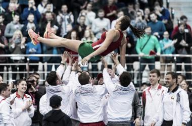 Belarus celebrates their success as a team   Photo: Daniel Kopatsch/Fed Cup
