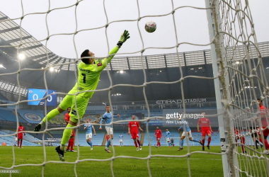 <div>MANCHESTER, ENGLAND - JANUARY 10: Bernardo Silva of Manchester City scores their side's first goal past Andres Prieto of Birmingham City during the FA Cup Third Round match between Manchester City and Birmingham City at Etihad Stadium on January 10, 2021 in Manchester, England. Sporting stadiums around England remain under strict restrictions due to the Coronavirus Pandemic as Government social distancing laws prohibit fans inside venues resulting in games being played behind closed doors. (Photo by Alex Livesey/Getty Images)</div><div><br></div>