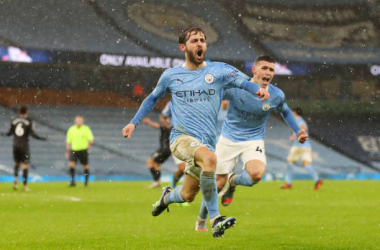 <div>MANCHESTER, ENGLAND - JANUARY 20: Bernardo Silva of Manchester City celebrates after scoring their team's first goal during the Premier League match between Manchester City and Aston Villa at Etihad Stadium on January 20, 2021 in Manchester, England. (Photo by Martin Rickett - Pool/Getty Images)</div>