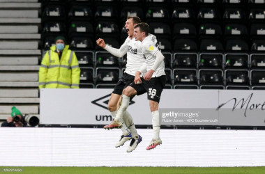 DERBY, ENGLAND - JANUARY 19: Krystian Bielik of Derby County scores a goal to make it 1-0 and celebrates with team-mate Jason Knight during the Sky Bet Championship match between Derby County and AFC Bournemouth at Pride Park Stadium on January 19, 2021 in Derby, England. Sporting stadiums around the UK remain under strict restrictions due to the Coronavirus Pandemic as Government social distancing laws prohibit fans inside venues resulting in games being played behind closed doors. (Photo by Robin Jones - AFC Bournemouth/AFC Bournemouth via Getty Images)