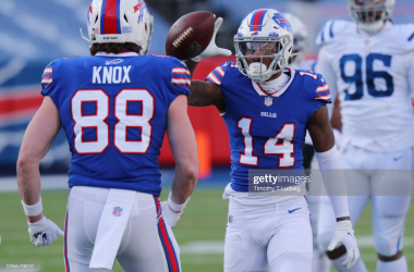 ORCHARD PARK, NEW YORK - JANUARY 09: Stefon Diggs #14 reacts with Dawson Knox #88 of the Buffalo Bills after making a first-down reception during the second half of the AFC Wild Card playoff game against the Indianapolis Colts at Bills Stadium on January 09, 2021 in Orchard Park, New York. (Photo by Timothy T Ludwig/Getty Images)