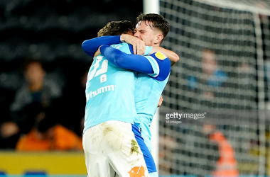 HULL, ENGLAND - AUGUST 18: Graeme Shinnie and Max Bird of Derby celebrate after the final whistle during the Sky Bet Championship match between Derby County and Hull City at the KC Stadium on August 18, 2021 in Hull, England. (Photo by VI-Images)