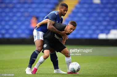 Leandro Trossard right holding off his man in the friendly against Birmingham. Image courtesy of Marc Atkins on Getty Images.