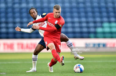 Riley McGree of Birmingham City and Daniel Johnson of Preston North End compete for the ball during the Sky Bet Championship match between Preston North End and Birmingham City at Deepdale on October 31, 2020, in Preston, England. (Photo by Nathan Stirk/Getty Images)