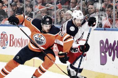 Oliver Bjorkstrand fights off Leon Draisaitl.   Photo: Edmonton Oilers on Twitter (@EdmontonOilers)