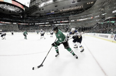 Jamie Benn #14 of the Dallas Stars skates the puck against Paul Stastny #26 of the St. Louis Blues in the third period in Game Seven of the Western Conference Second Round during the 2016 NHL Stanley Cup Playoffs at American Airlines Center on M