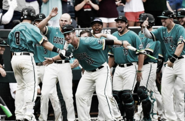 Coastal Carolina's Tyler Chadwick (8) is greeted at the dugout by teammates, including Seth Lancaster (26), after hitting a solo home run Saturday during the second inning of their College World Series game against TCU in Omaha, Neb. Ted Kirk APRead more