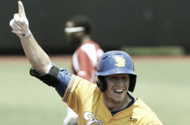 UC Santa Barbara pinch-hitter Sam Cohen celebrates as he rounds the bases after hitting a walk-off grand slam against Louisville on Sunday. (Timothy D. Easley / Asociated Press)