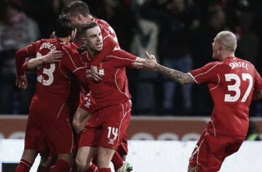 Liverpool celebrate after scoring against Bolton.