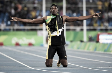 Usain Bolt rests on his knees as he marvels at the crowd of roaring fans after his ninth gold medal in three Olympic Games. Photo Credit: James Lang/USA TODAY Images.
