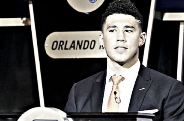 PhoenixSuns guard Devin Booker listens as the results of the NBA basketball draftlottery are announced, Tuesday, May 17, 2016, in New York. |AP Photo/Julie Jacobson|