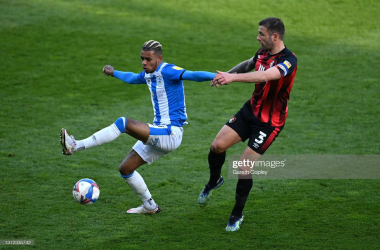 <div>Huddersfield Town v AFC Bournemouth - Sky Bet Championship</div><div>HUDDERSFIELD, ENGLAND - APRIL 13: Juninho Bacuna of Huddersfield Town (l) is challenged by Steve Cook of Bournemouth during the Sky Bet Championship match between Huddersfield Town and AFC Bournemouth at John Smith's Stadium on April 13, 2021 in Huddersfield, England. Sporting stadiums around the UK remain under strict restrictions due to the Coronavirus Pandemic as Government social distancing laws prohibit fans inside venues resulting in games being played behind closed doors. (Photo by Gareth Copley/Getty Images)</div>