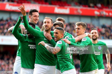 Brighton celebrating their equalising goal against Arsenal. Image courtesy of Catherine Ivill on Getty Images.