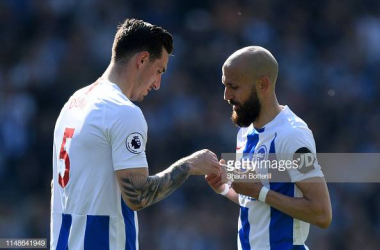 Bruno(right) handing over the captains armband to Lewis Dunk(left) when he was substituted against Manchester City in the last game of the season. Image courtesy ofShaun Botterill on Getty Images.