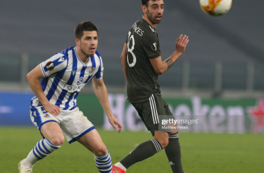 <div>Real Sociedad v Manchester United - UEFA Europa League Round Of 32 Leg One</div><div>TURIN, ITALY - FEBRUARY 18: Bruno Fernandes of Manchester United in action with Igor Zubeldia of Real Sociedad during the UEFA Europa League Round of 32 match between Real Sociedad and Manchester United at Allianz Stadium on February 18, 2021 in Turin, Italy. (Photo by Matthew Peters/Manchester United via Getty Images)</div>