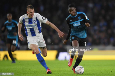 Dan Burn in action for Brighton against West Bromwich Albion, image courtesy of Mike Hewitt on Getty Images.