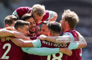 WOLVERHAMPTON, ENGLAND - APRIL 25: Burnley's Ashley Westwood celebrates scoring his side's fourth goal with teammates during the Premier League match between Wolverhampton Wanderers and Burnley at Molineux on April 25, 2021 in Wolverhampton, United Kingdom. (Photo by Alex Dodd - CameraSport via Getty Images)