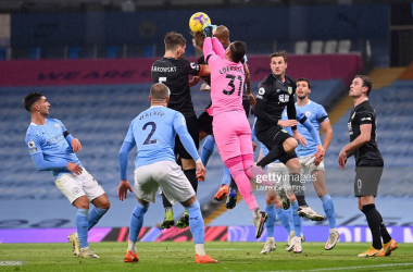 MANCHESTER, ENGLAND - NOVEMBER 28: Ederson of Manchester City clashes with James Tarkowski of Burnley during the Premier League match between Manchester City and Burnley at Etihad Stadium on November 28, 2020 in Manchester, England. Sporting stadiums around the UK remain under strict restrictions due to the Coronavirus Pandemic as Government social distancing laws prohibit fans inside venues resulting in games being played behind closed doors. (Photo by Laurence Griffiths/Getty Images)