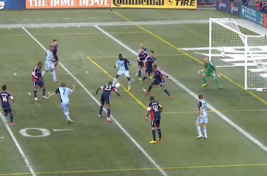 The football lines at Gillette Stadium for Liguilla MLS were an eyesore for fans. It still did not keep Dorman (white) from keeping Aurelien Collin (navy/blue) onside. Image courtesy of @andrew_wiebe.