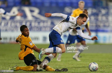 BIRKENHEAD, ENGLAND - OCTOBER 18: Tranmere's Kieron Morris is challenged by Southend United's Tim Dieng during the Sky Bet League One match between Tranmere Rovers and Southend United at Prenton Park on October 18, 2019 in Birkenhead, England. (Photo by Lewis Storey/Getty Images)