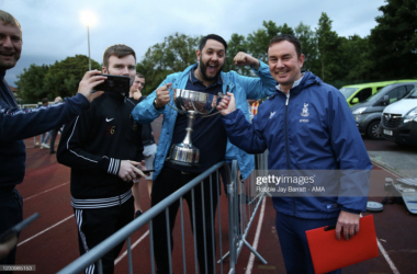 Above: New Bradford City manager Derek Adams celebrates winning the Tom Banks Memorial Trophy with some loyal Bradford fans. (Photo by Robbie Jay Barratt/Getty Images)