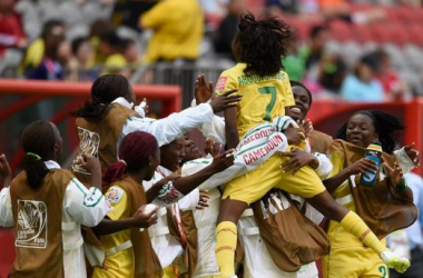 Gabrielle Onguene celebrates after converting her penalty / courtesy FIFA.com