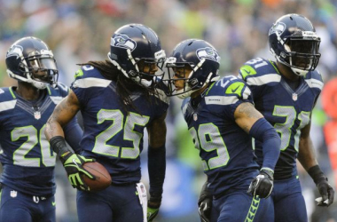 Jeremy Lane (20), Richard Sherman (25), Earl Thomas (29) and Kam Chancellor (31) help key Seattle's defense, which produced three turnovers against the Panthers. Credit: Steven Bisig, USA Today Sports.
