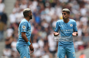 Joao Cancelo and Riyad Mahrez in discussion |(Photo by James Williamson - AMA/Getty Images)