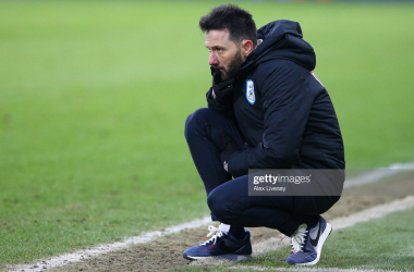 <div>Huddersfield Town v Wycombe Wanderers - Sky Bet Championship</div><div>HUDDERSFIELD, ENGLAND - FEBRUARY 13: Carlos Corberan, Manager of Huddersfield Town reacts during the Sky Bet Championship match between Huddersfield Town and Wycombe Wanderers at John Smith's Stadium on February 13, 2021 in Huddersfield, England. Sporting stadiums around the UK remain under strict restrictions due to the Coronavirus Pandemic as Government social distancing laws prohibit fans inside venues resulting in games being played behind closed doors. (Photo by Alex Livesey/Getty Images)</div>