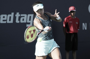 Carol Zhao, the only Canadian to make it past the first round of qualifying on Saturday, hits a forehand during her win over Veronica Cepede Royg at the 2017 Rogers Cup presented by National Bank. | Photo: Max Gao