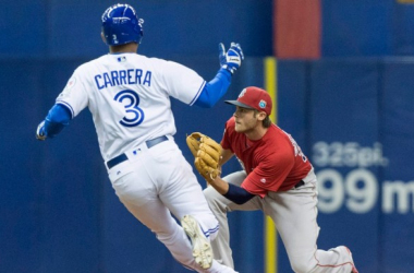 Ezequiel Carrera slides into second base during Saturday's action at Olympic Stadium. (Paul Chiasson/CP)