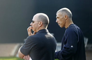 Yankees general manager Brian Cashman (L) and Manager Joe Girardi #28 of the New York Yankees watch bullpen practice during a spring training workout on February 26, 2015 at George M. Steinbrenner Field in Tampa, Florida. (Feb. 26, 2015 - Source: Brian Bl