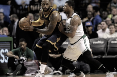 Cleveland Cavaliers forward LeBron James (23) being defended by Boston Celtics guard Marcus Smart (36).Photo :Bob DeChiara/USA-TODAY Sports