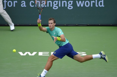 Vasek Pospisil hits a forehand in first round match at Indian Wells.   Photo: BNP Paribas Open