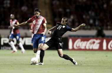 Bryan Ruiz (left) wins a ball off of Timothy Chandler (right) in Costa Rica's World Cup qualifying victory over the United States. Photo credit: Mexsport