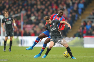 LONDON, ENGLAND - NOVEMBER 03: Ben Chilwell of Leicester City is tackled by Christian Benteke of Crystal Palace during the Premier League match between Crystal Palace and Leicester City at Selhurst Park on November 03, 2019 in London, United Kingdom. (Photo by Catherine Ivill/Getty Images)