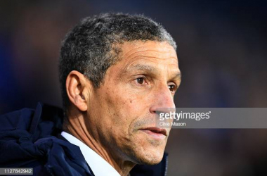 Chris Hughton in the dugout at The Hawthorns image courtesy of Clive Mason on Getty Images.