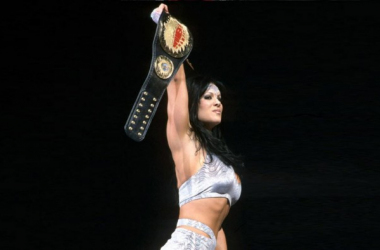 Chyna the Ninth Wonder of the World holding her Women's Championship which she left with in 2001 upon her departure from the company.  Photo credit: WWE.com