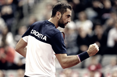 Marin Cilic pumps his fist during his comeback doubles win on Saturday in Osijek. Photo: Predrag Milosavljevic/Davis Cup