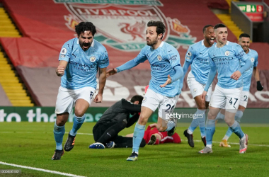 <div>LIVERPOOL, ENGLAND - FEBRUARY 07: Ilkay Gundogan of Manchester City celebrates with team mate Bernardo Silva after scoring their side's first goal during the Premier League match between Liverpool and Manchester City at Anfield on February 07, 2021 in Liverpool, England. Sporting stadiums around the UK remain under strict restrictions due to the Coronavirus Pandemic as Government social distancing laws prohibit fans inside venues resulting in games being played behind closed doors (Photo by Jon Super - Pool/Getty Images)</div><div><br></div>