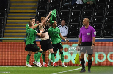 Sam Clucas lifts his shirt to the Swansea fans. (Credit: Athena Pictures/Getty Images)