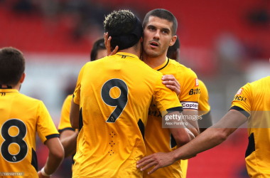 Coady celebrates with Jimenez after the forward's equaliser at Stoke City.(Photo by Alex Pantling/Getty Images)