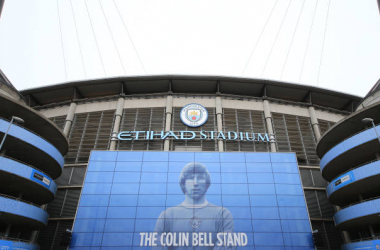 <div>MANCHESTER, ENGLAND - JANUARY 26: The Colin Bell Stand at the Etihad Stadium on January 26, 2021 in Manchester, England. Former City player Colin Bell passed away earlier in the month and the funeral was held this afternoon at St Peter's Church in Hale. (Photo by Tom Flathers/Manchester City FC via Getty Images)</div>