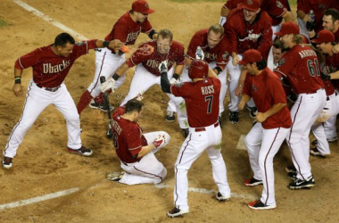 Miguel Montero #26 of the Arizona Diamondbacks is congratulated by teammates after hitting a walk off solo home-run against the Colorado Rockies in the MLB game at Chase Field on April 30, 2014 in Phoenix, Arizona. The Diamodbacks defeated the Rockies 5-4