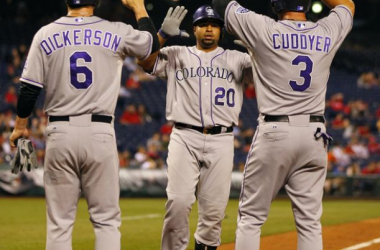 Wilin Rosario #20 of the Colorado Rockies is congratulated by teammates Corey Dickerson #6 and Michael Cuddyer #3 after hitting a three-run home run during the seventh inning against the Philadelphia Phillies at Citizens Bank Park on May 27, 2014 in Phila