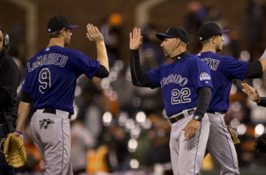 DJ LeMahieu #9 of the Colorado Rockies is congratulated by manager Walt Weiss #22 after the game against the San Francisco Giants at AT&T Park on April 14, 2015 in San Francisco, California. The Colorado Rockies defeated the San Francisco Gi