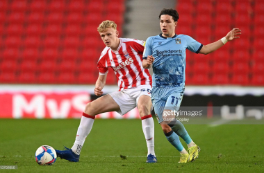 STOKE ON TRENT, ENGLAND - APRIL 21: Conner Taylor of Stoke City battles for possession with Callum O'Hare of Coventry City during the Sky Bet Championship match between Stoke City and Coventry City at Bet365 Stadium on April 21, 2021 in Stoke on Trent, England. Sporting stadiums around the UK remain under strict restrictions due to the Coronavirus Pandemic as Government social distancing laws prohibit fans inside venues resulting in games being played behind closed doors. (Photo by Gareth Copley/Getty Images)