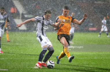 Leander Dendoncker tries to stop Conor Gallagher's cross in the pouring rain at the Hawthorns. (Photo by Geoff Caddick - Pool/Getty Images)