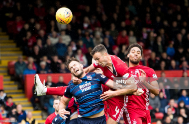 Aberdeen's Andy Considine challenges County's Keith Watson in the air (Getty Images: Scott Baxter)